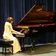 Rachel - Online Classical Guitar Guitar Piano  teacher